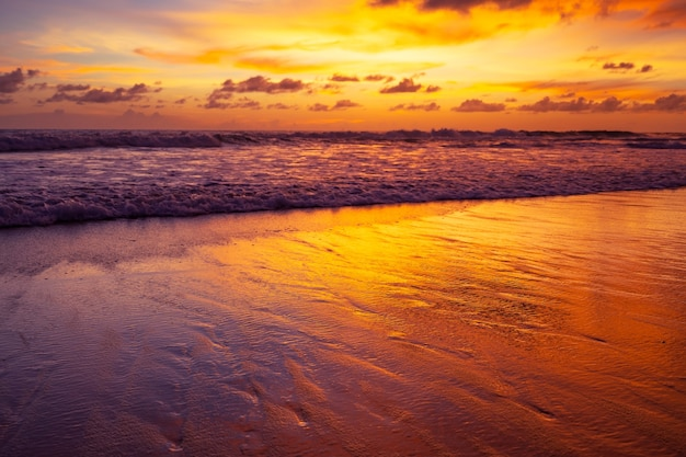 Amazing detail sandy beach landscape long exposure of majestic clouds in the sky sunset or sunrise over sea with reflection in the tropical sea beautiful cloudscape amazing light of nature landscape.