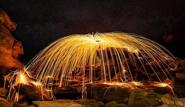 Amazing fire show performance in the night sky
