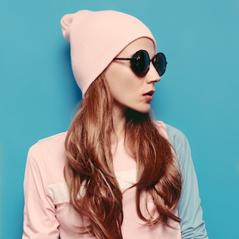 Amazing girl autumn -spring fashion outfit. vanilla style hipster trend girl swag beanie hat. stylish vintage glasses. pink vibration