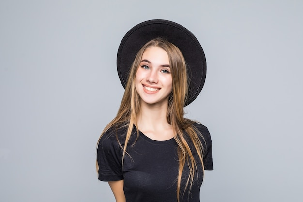 Amazing lady with gold hair dressed up in black with retro hat smiles isolated on background