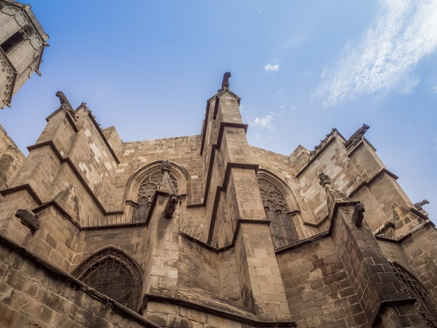 Amazing low angle view of the chapel of st. agatha and roman wall in barcelona