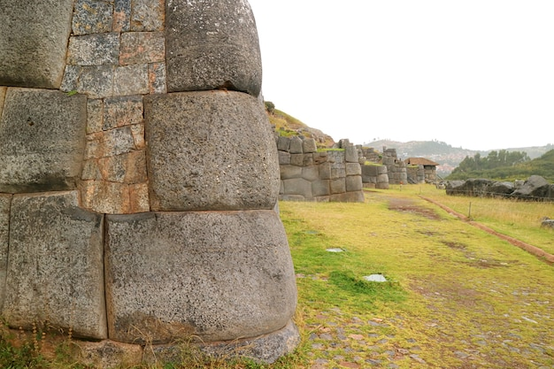 Amazing massive ancient inca stone wall of sacsayhuaman fortress, cusco, peru, south america