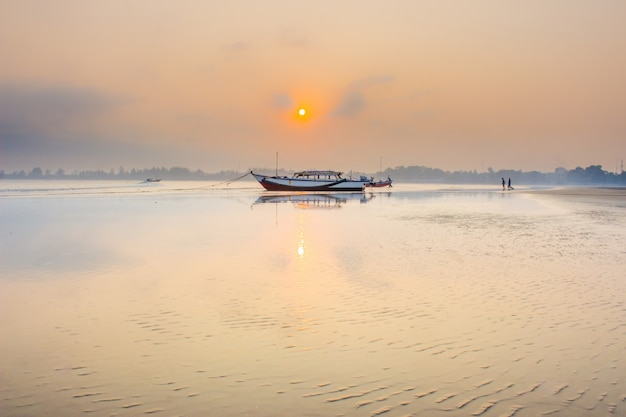 Amazing morning with sunrise moment at boat in bengkulu, indonesia