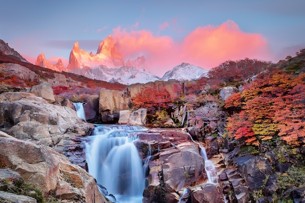 Amazing mount fitz roy and the waterfall at pink dawn, los glaciares national park, andes, patagonia, argentina