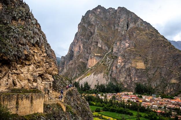 Amazing scenery of ollantaytambo town among huge rocky mountains
