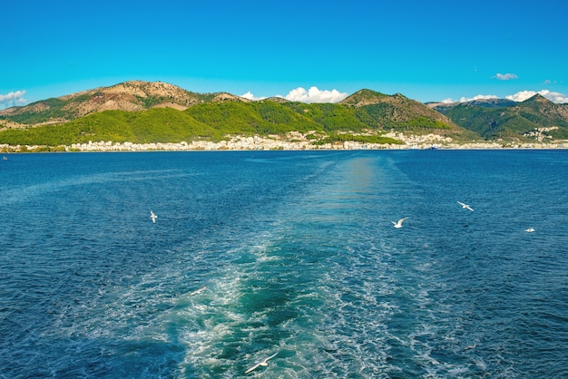 Amazing sealine with crystal clear water, trail after boat, greece. beautiful landscape of ionian sea, island. sunny weather.