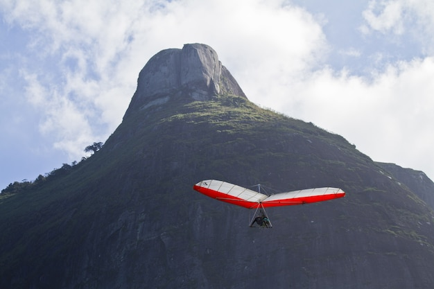 Amazing shot of human flying on a hang glider