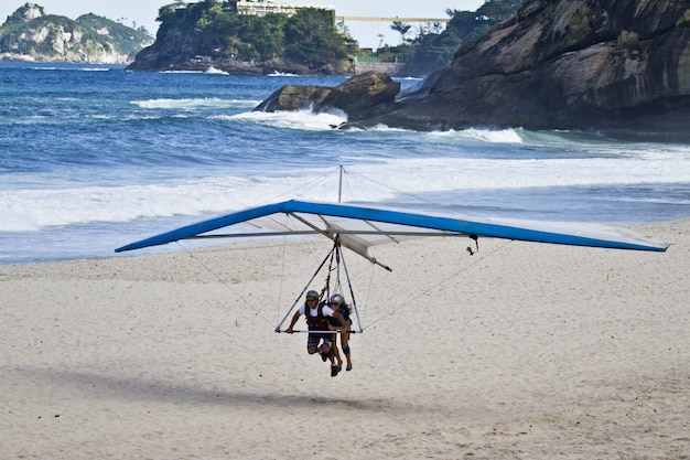 Amazing shot of human trying to fly on a hang glider