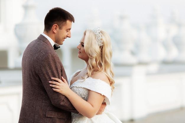 Amazing smiling wedding couple. pretty bride and stylish groom.