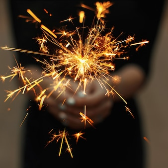 Amazing sparklers in female hands