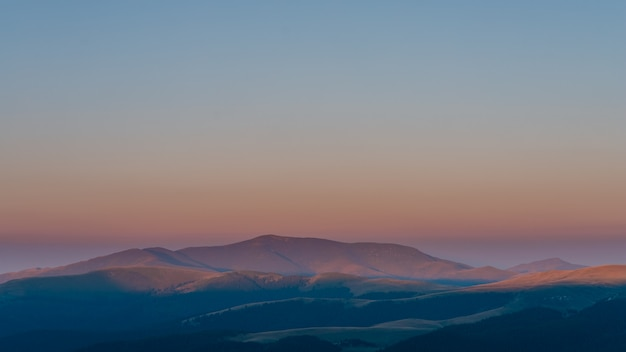 Amazing summer sunrise with beautiful orange lights on summit montains, bucegi park at sunrise, carpathian mountains. sunrise light