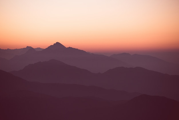 Amazing sunset over the hills and mountains