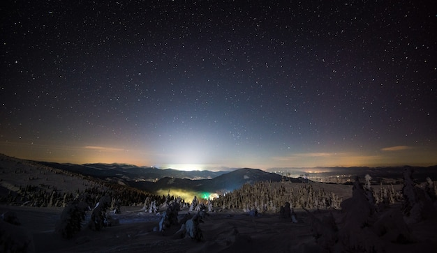 Amazing view of the beautiful ski slopes on a late starry night