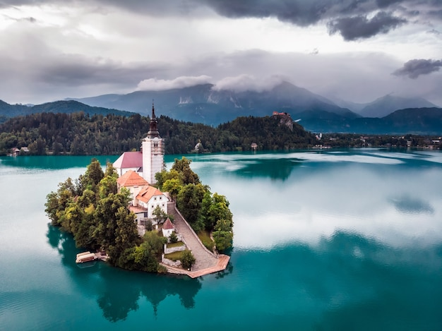 Amazing view on bled lake, island,church and castle with mountain range