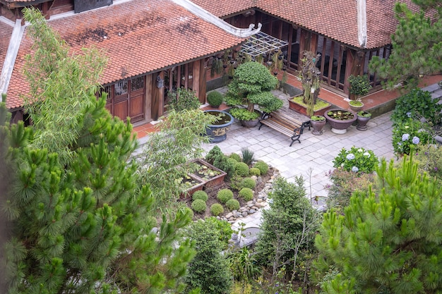 Amazing view of buddhist monastery and courtyard garden with flowers and bonsai trees in bana hill, tourism site in da nang, vietnam