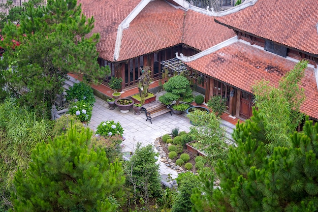 Amazing view of buddhist monastery and courtyard garden with flowers and bonsai trees