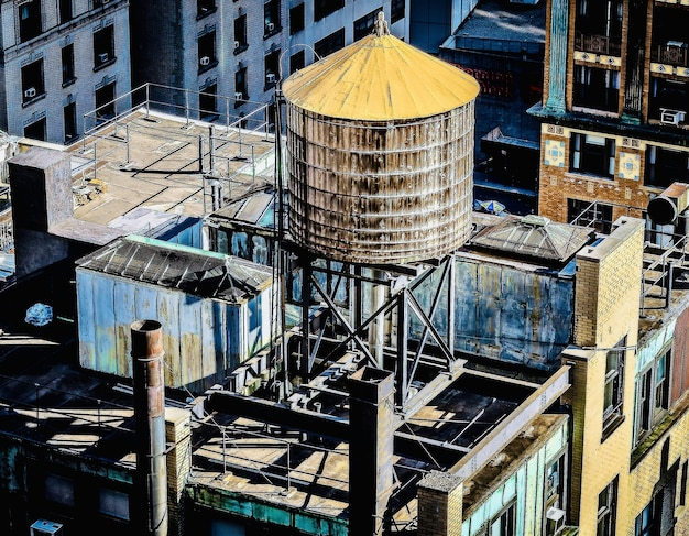 Amazing view of a downtown building roof with a water tank on it