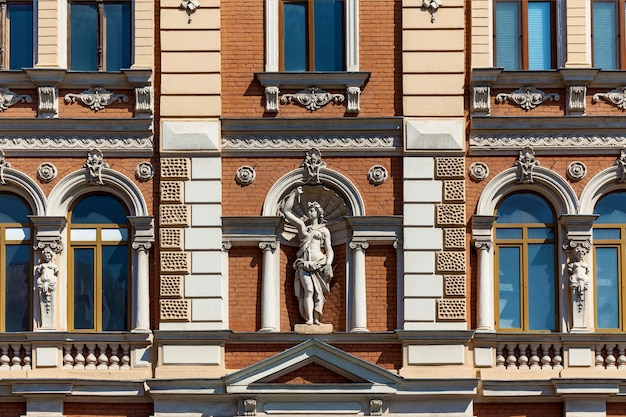 An amazing view of a vintage facade of a building with decorative elements and sculptures o