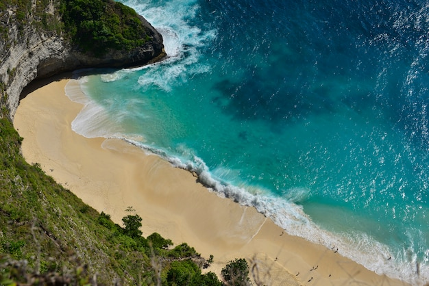 Amazing wonderful seashore aerial view of beach in nusa penida, bali island, indonesia.