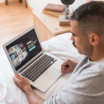 Amazon prime video app on laptop in bedroom