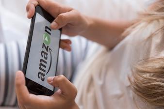 Amazon prime video app on smartphone in bedroom