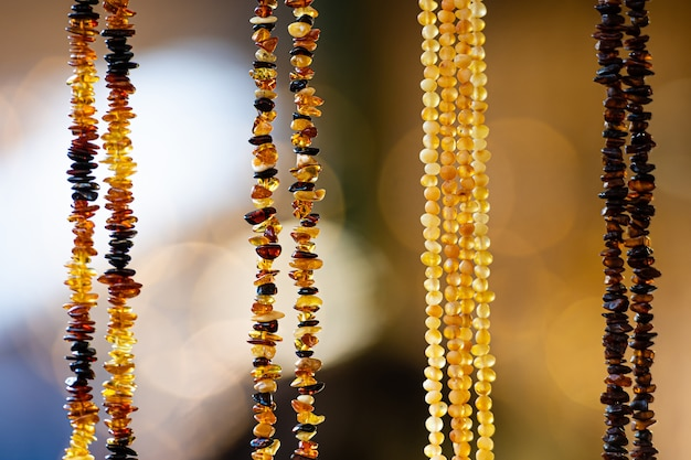 Amber background of beads and necklaces at the handicraft market. souvenirs from baltic countries
