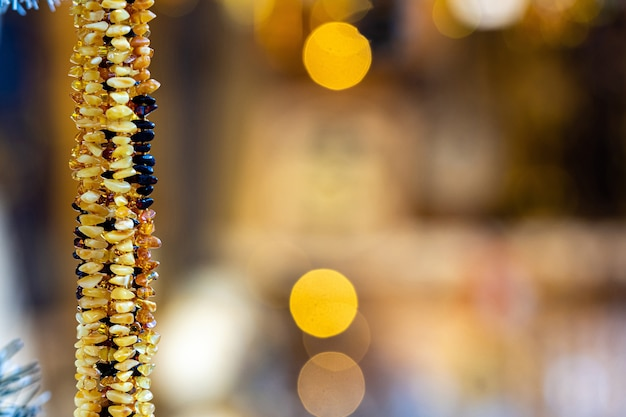 Amber background of beads and necklaces at the handicraft market