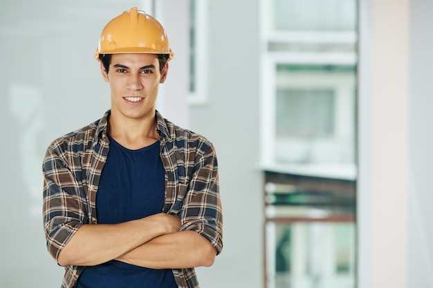Ambitious construction engineer smiling