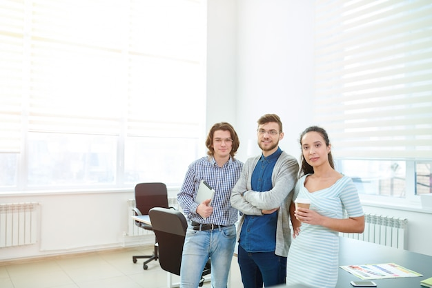 Ambitious young office employees in board room