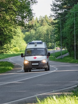 Ambulance in motion on a forest road