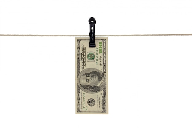 American 100 dollar bank note in a clothesline - money laundering - dirty money  concept - isolated