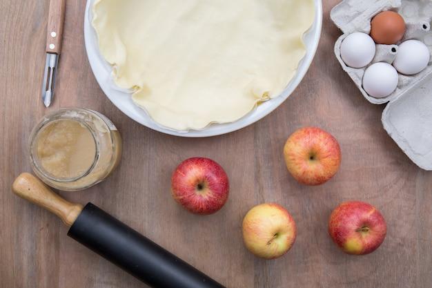 American apple pie preparation in rustic