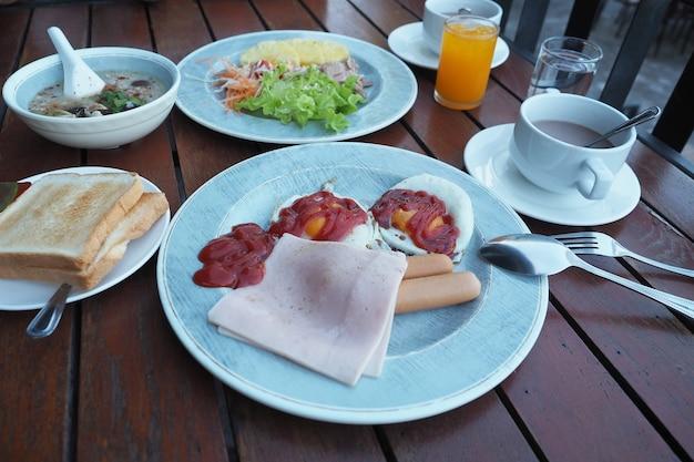 American breakfast in ceramic dish on wood table