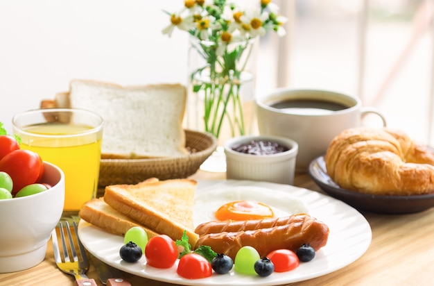 American breakfast with fried egg toast sausage fruits vegetable coffee croissant