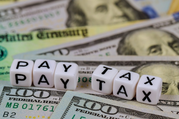 American day pay tax with stimulus economic tax return check and usa dollar cash banknote