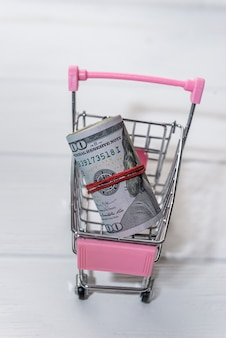 American dollar banknotes in roll in cart