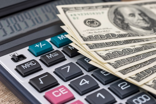 American dollar with calculator  tax concept