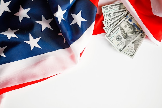 American dollars cash money.  one hundred dollars banknotes close-up on  usa flag background