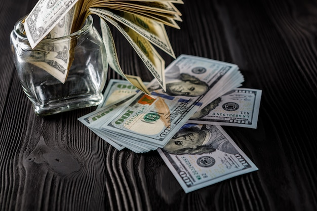 The american dollars in a glass jar