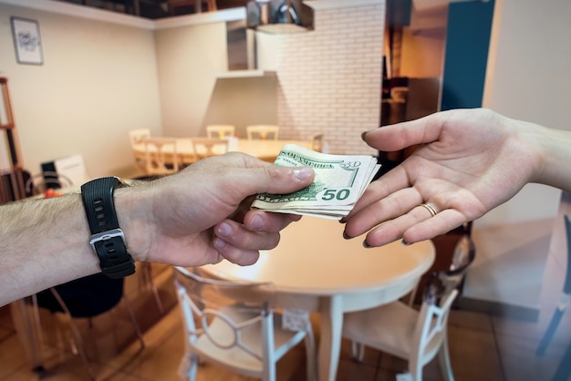 American dollars in the hands after successful rental agreement