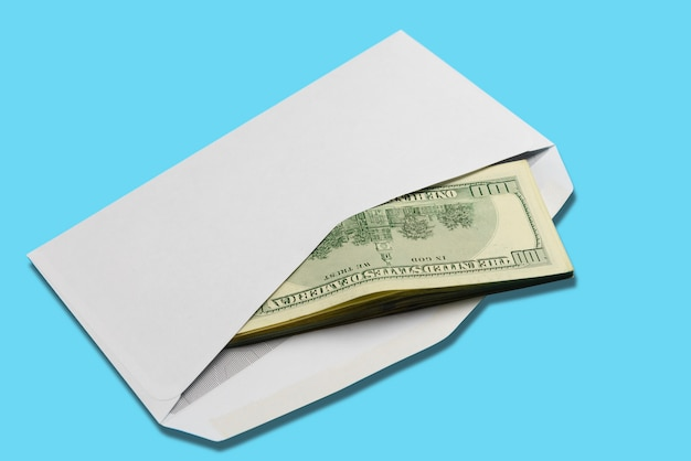 American dollars in open white postal envelope on blue