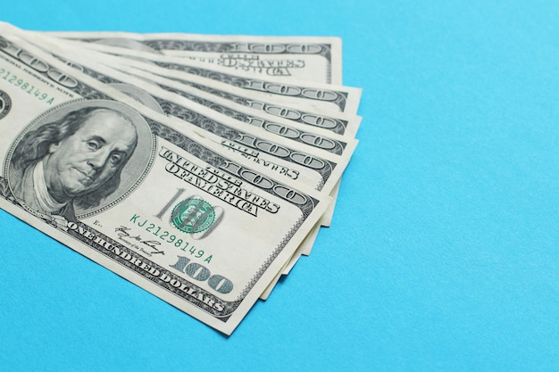 American dollars. a stack of hundred dollar bills.
