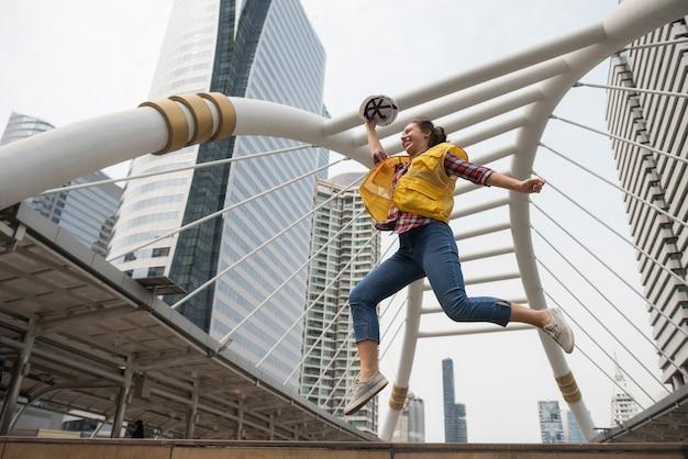 American female engineer jump in city