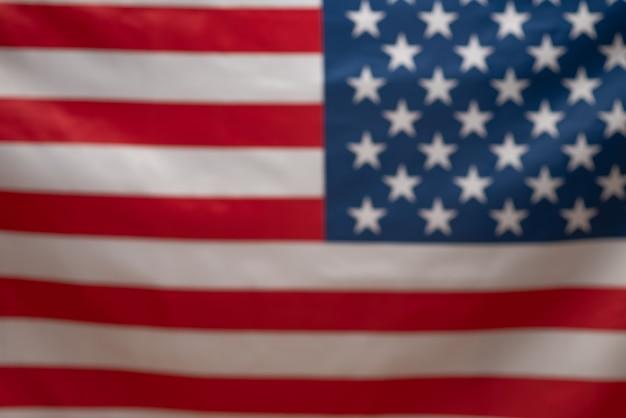 Американский флаг в качестве фона. размытый фон.