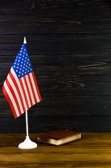 American flag background with book