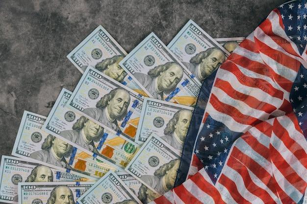 American flag and banknotes 100 usa dollar bill