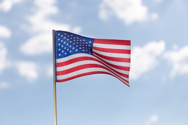 American flag on blue sky with clouds