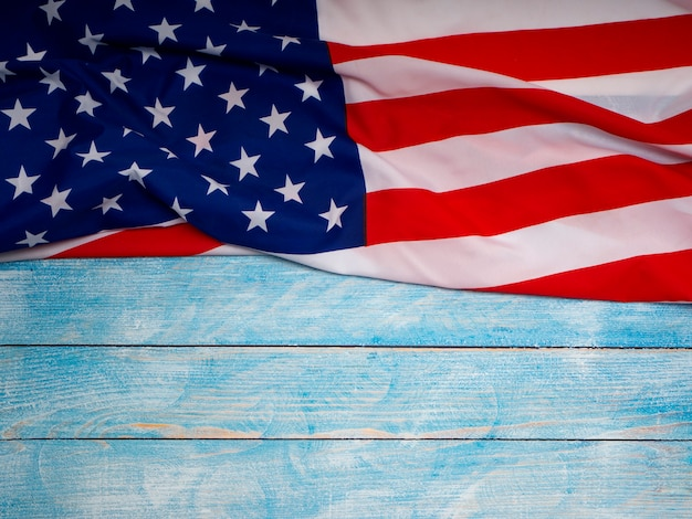 American flag on blue wooden background