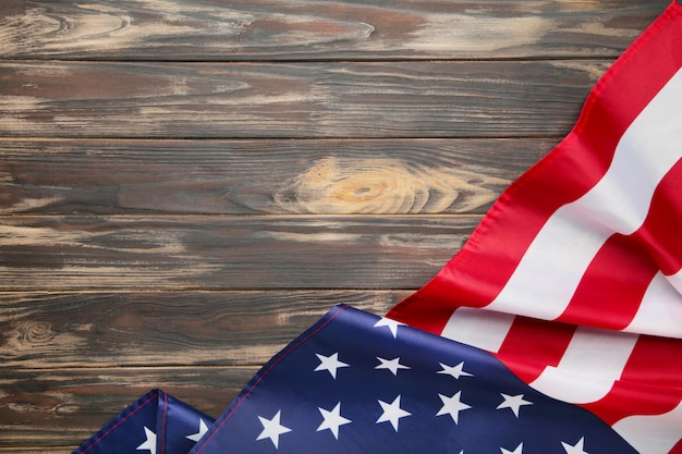 American flag on brown wooden background with copy space