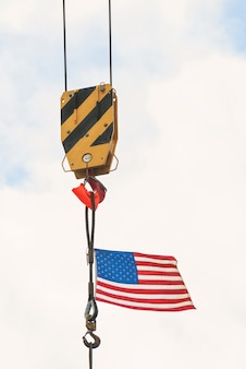 American flag on a construction building crane in boston
